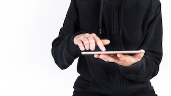 Midsection view of a person's hand using digital tablet