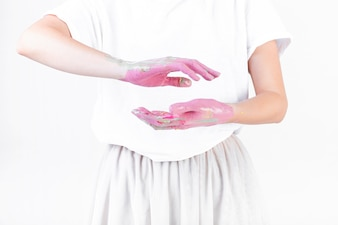 Midsection view of a woman's hand with pink paint