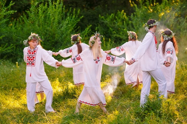 Midsummer, a group of young people of slavic appearance at the celebration of midsummer.