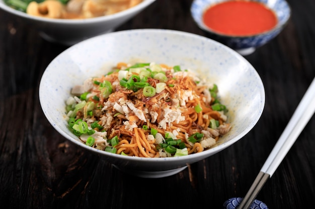 Mie ayam indonesian popular street food with noodle chicken and green vegetables  delicious broth