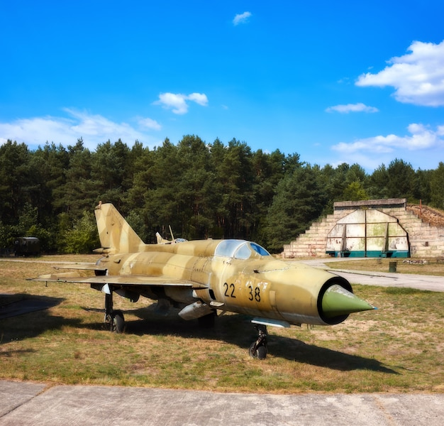 Mig 17, an old russian airplaine on an old airfield