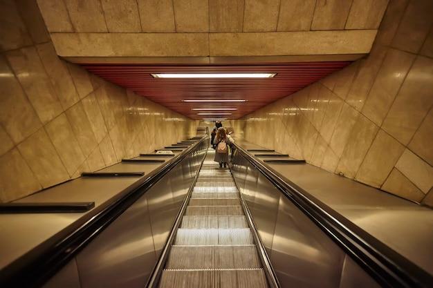Milan, italy 10 march 2020: escalators go down to the milan metro Premium Photo