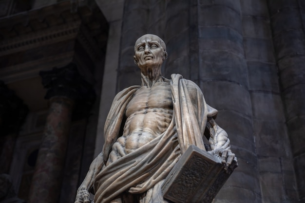Milan, italy - june 27, 2018: closeup marble sculpture in milan cathedral (duomo di milano) is the cathedral church of milan
