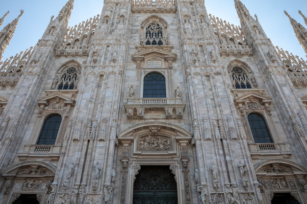 Milan, italy - june 27, 2018: panoramic view of exterior of milan cathedral (duomo di milano) is cathedral church of milan. dedicated to st mary of nativity, it is seat of the archbishop of milan