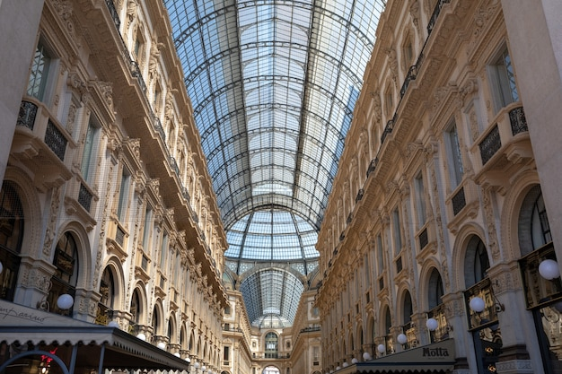 Milan, italy - june 27, 2018: panoramic view of interior of galleria vittorio emanuele ii. it is italy's oldest active shopping mall and major landmark of milan on piazza del duomo (cathedral square)