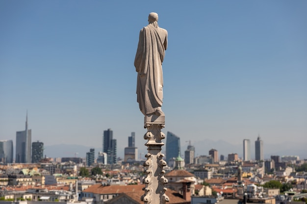 Milan, italy - june 27, 2018: panoramic view of milan city with modern buildings from milan cathedral (duomo di milano). summer sunny day and blue sky