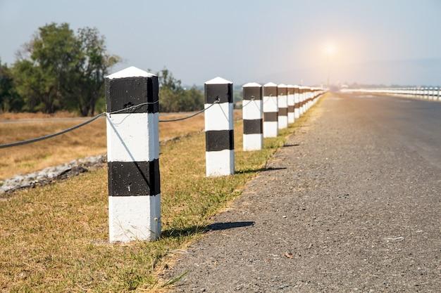 Milestones,black and white milestones roadside