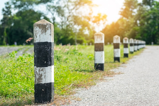 Milestones - black and white milestones with green grass roadside. concept for next step.