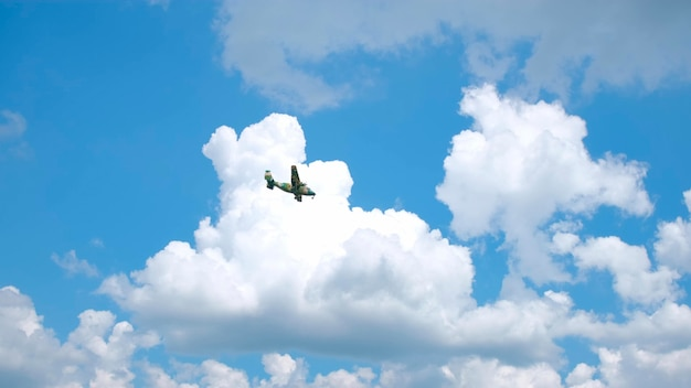 Military aircraft flying through the sky
