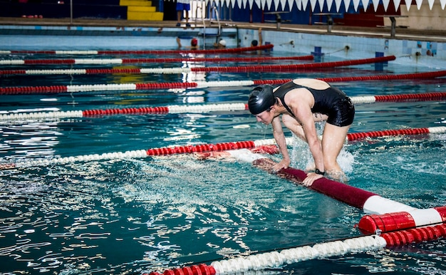 Military cadet in swimming practice