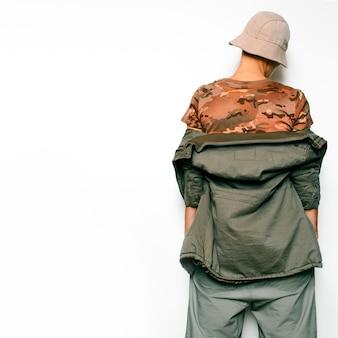 Military fashion style. urban hipster fashion model dancer