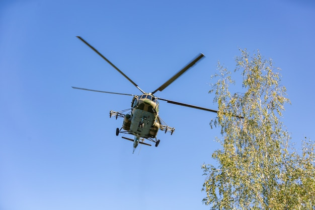 Military helicopter flying during exercise performing a military demonstration