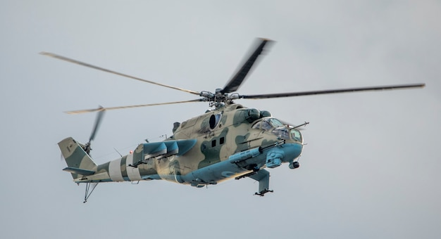 Military helicopter on a mission on a background of the sky.