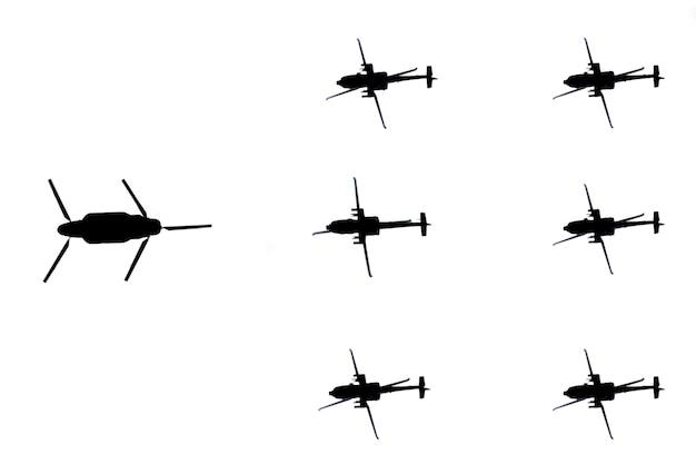 흰색 바탕에 군사 헬리콥터 실루엣입니다.
