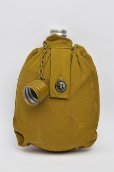 Military khaki lined liquid flask with open lid on chain on white clipping background
