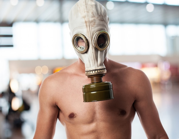 Military man with gas mask