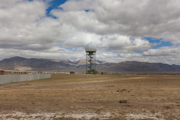 Military radio station, round building of radar antenna. altai, russia Premium Photo