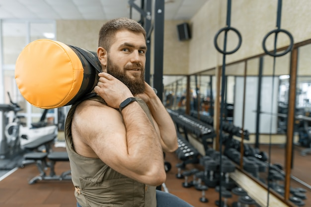 Military sport, muscular caucasian bearded adult man doing exercises