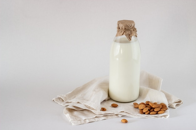 Milk and almonds on a white background