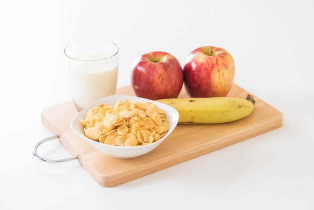 Milk, apple, banana and cornflakes
