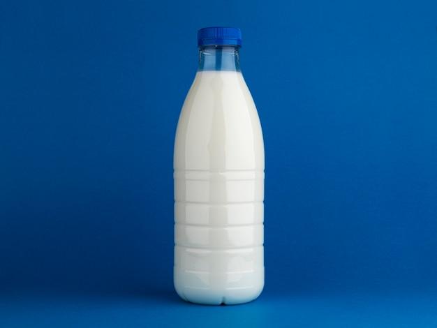 Milk bottle mock up isolated on blue background