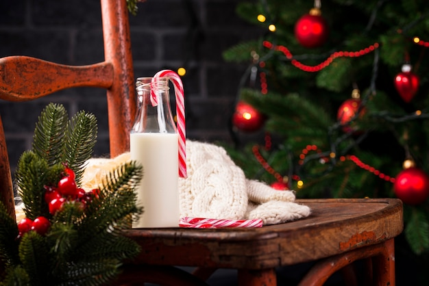 Milk in bottle on old rustic chair
