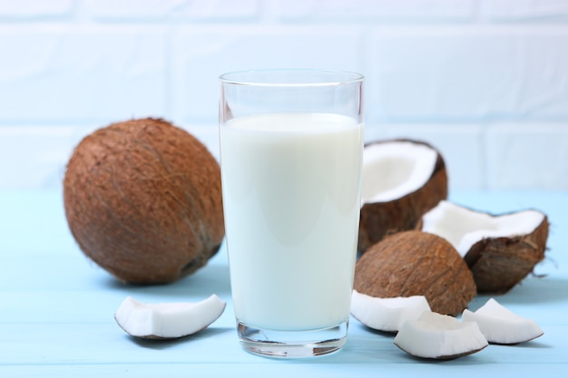Milk and broken coconuts on the table vegetable milk a veggie drink