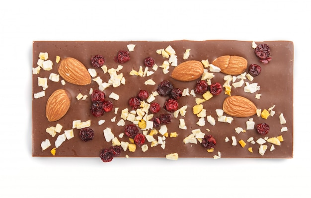 Milk chocolate bar with almonds and dried fruits isolated on white background
