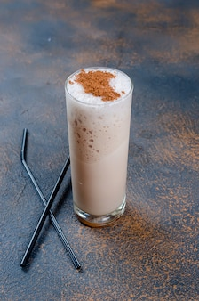 Milk chocolate cocktail or cold whipped coffee with milk