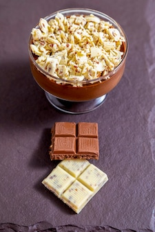 Milk chocolate mousse with chocolate shavings.