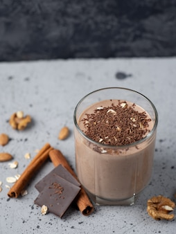 Milk chocolate smoothie with cocoa nuts cinnamon