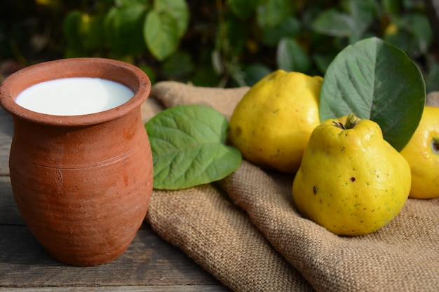 Milk in a clay pot and quince