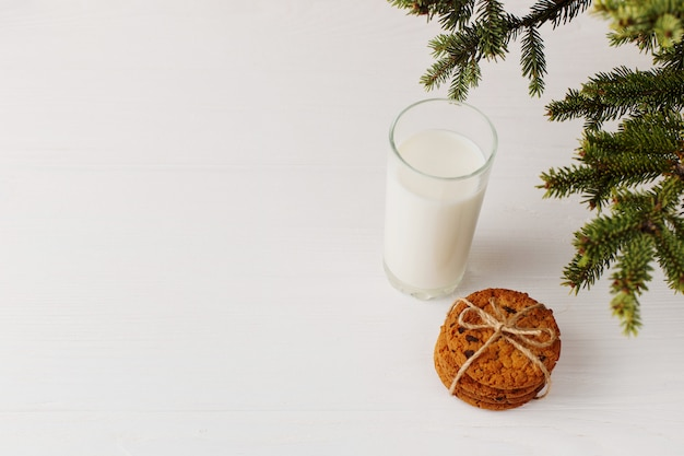 Milk and cookies for santa claus under the christmas tree
