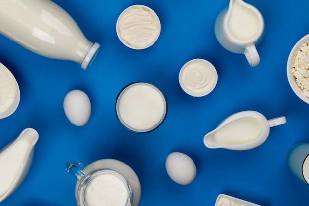 Milk, cottage cheese, sour cream and yogurt, top view, flat lay