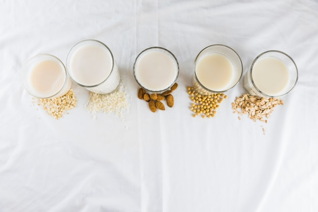 Milk in different types of glasses and cereals