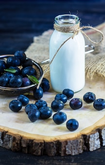 Milk and fresh blueberries