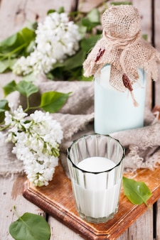 Milk home and sprig of lilac