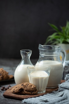 Milk products tasty healthy dairy products on a table on sour cream in a bowl, cottage cheese bowl, cream in a a bank and milk jar, glass bottle and in a glass.