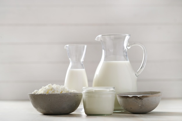 Milk products on wooden table