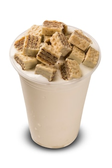 Milk shake with chocolate pieces. white background