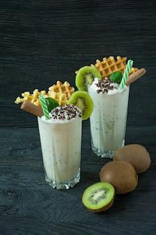 Milk shake with kiwi, ice cream and whipped cream