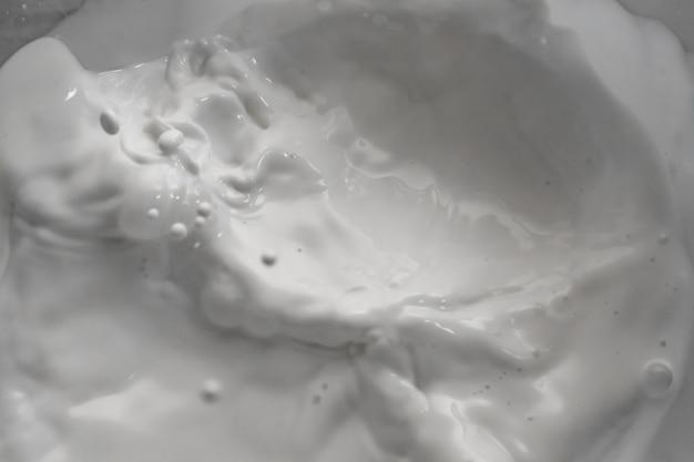 Milk splashing waves isolated white background