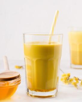 Milk tea with turmeric on white background