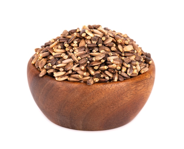 Milk thistle seed in wooden bowl, isolated on white background. silybum marianum, scotch thistle or marian thistle.
