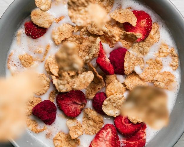 Milk with musli and dried raspberries