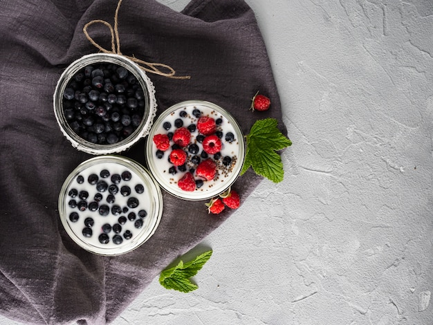 Milk yogurt with blueberries, raspberries, detox. copy space.