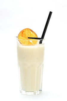 Milkshake with orange on white background