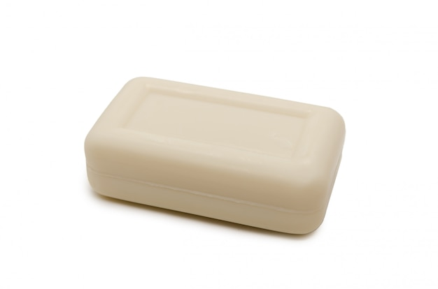 Milky-colored rectangular piece of soap isolated