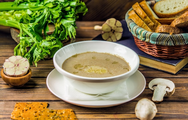 Milky creamy mushroom soup served with crackers