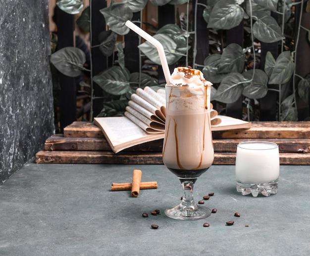 Milky shake with chocolate syrup and cinnamon